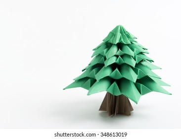 Origami Christmas tree with natural shadow