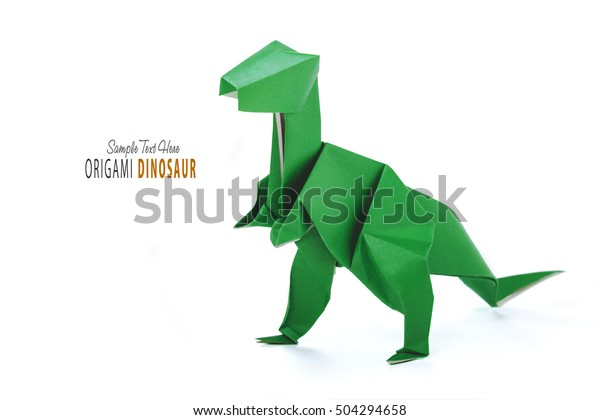 Origami dinosaur on white