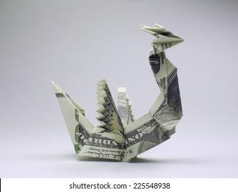Origami dragon made of hundred dollar bills