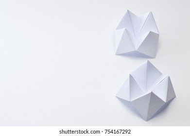 Origami figure paper in white background, ideal for your education projects or origami topics in your publications.
