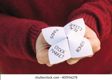 Origami fortune teller with investment choices. Ideal image for financial consultancy themes.
