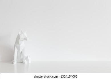 Origami fox design sculpture home decor near white wall mock up.