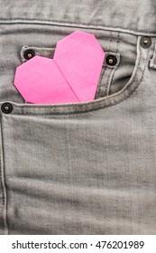 origami heart in grey jean pocket