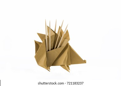 Origami Hedgehog with toothpicks on white background