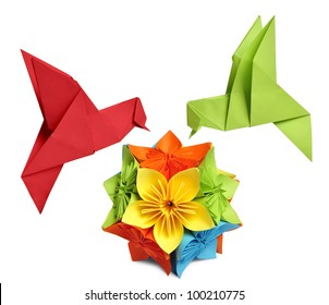 origami hummingbird over flower kusudama over white background