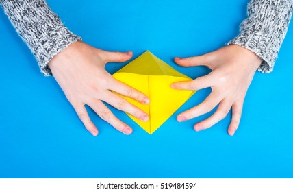 Origami on a blue background