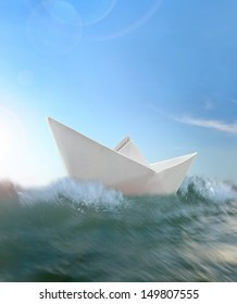 Origami paper boat floating in a sea