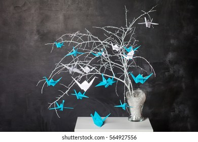 Origami paper cranes on n branches