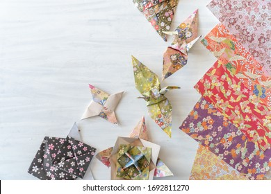 Origami paper and folded shapes on Table from Above with Copy Space