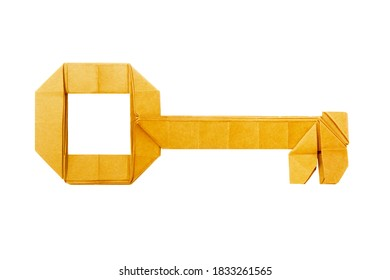 Origami paper golden key on a white background