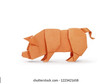 Origami paper pig isolated on white. Year of the pig. Clipping path included