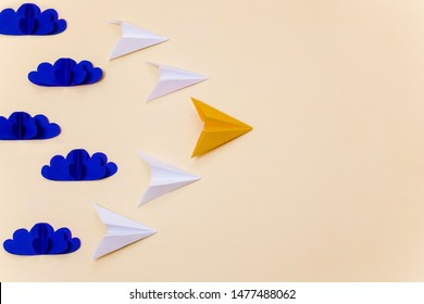 Origami paper planes and 3d clouds for leadership concept. Creative craft composition for banner/landing page/background.