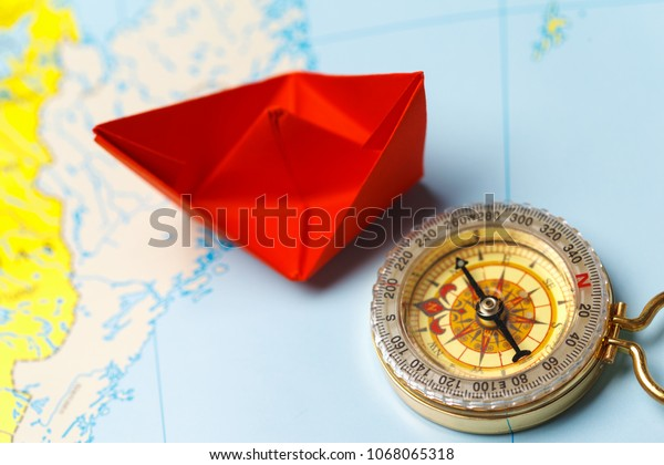 Origami paper ship on a map. Leadership and travelling concept ... | 420x600
