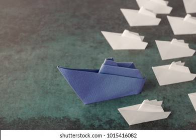 Origami paper ships, leadership business concept