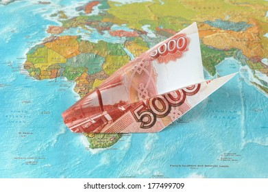 Origami plane made from rubles on the map