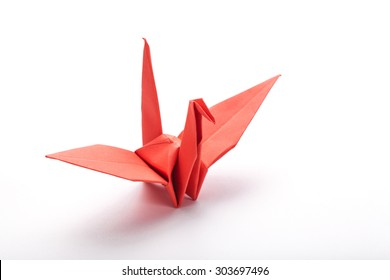 origami red bird paper on white background.