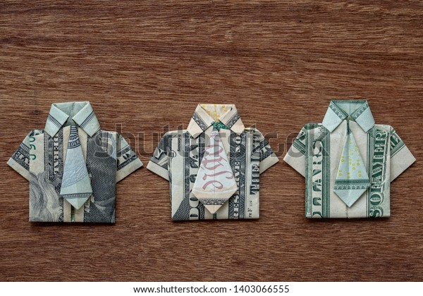 Dollar origami shirt and tie isolated on white background ... | 420x600