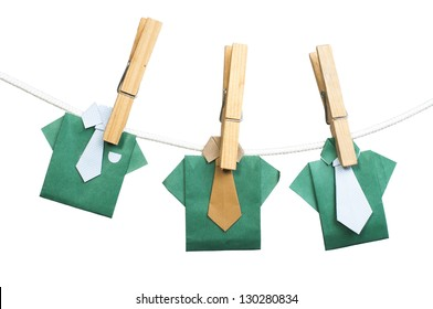 Origami shirts on rope. White isolated