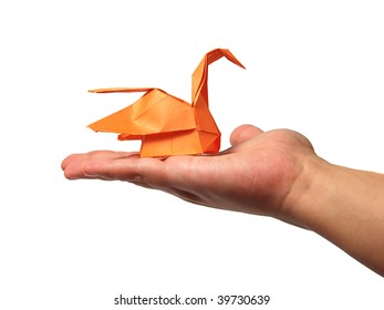 Origami swan in hand