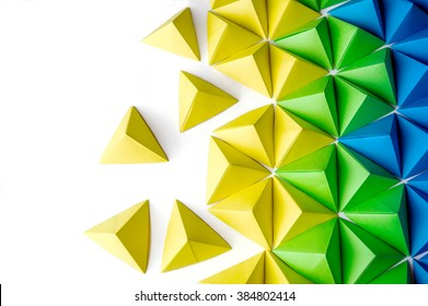 Origami tetrahedrons background. Futuristic polygonal composition with copy space on the left side.