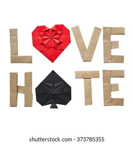 Origami text LOVE HATE on white background isolated. Space for copy, lettering. Red paper heart, black spades symbol. No shaddow.