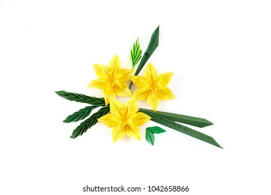 origami yellow paper narcissus on white background