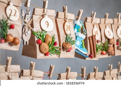 Original Advent Calendar for Christmas hanging on a string on the background of gray wall