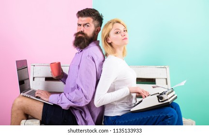 Original authentic attribute writer. True autor authentic equipment. Colleagues different work approach. Couple writers use different gadgets write book. Man use laptop girl like retro typewriter.