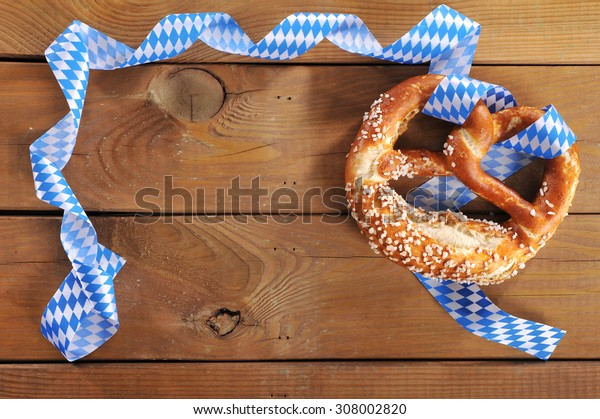 original bavarian salted soft pretzel from Germany in front of wooden board