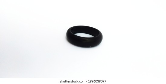 The original black round kokka ring made from kokka fruit seeds with a landscape background