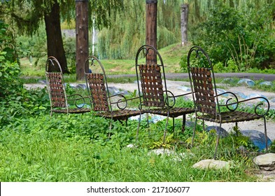 Original chairs with leather and iron in nature