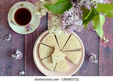 Original czech Kolonada spa waffer triangles:  Traditional chocolate filled biscuits, vintage cup of tea, lilac blossoms