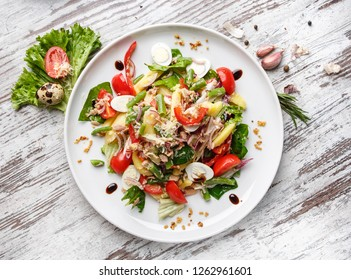 An original dish with decorations on a light background. Home cuisine. Flay lay. Top view