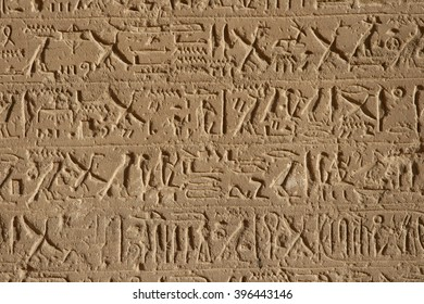 The original Egyptian hieroglyphics on the walls of the temple of Luxor.