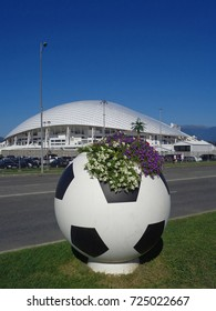 Original flower bed in the shape of soccer ball, football stadium behind, Sochi, Russia, September 9, 2017