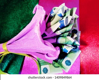 An original gift, a bouquet of 100 euros per pack corrugated paper. A lump  of money won in a lottery or casino. Bank interest on the Deposit.