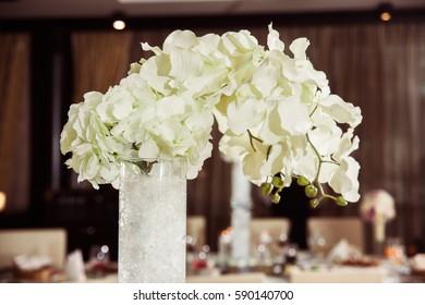 Original huge vase of beautiful white hydrangea. Close-up