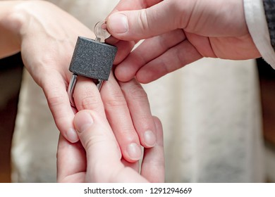 original idea and conception of bonds of marriage, demonstrating unfreedom and obligations. As a wedding ring, the groom puts a padlock on the finger of the bride and closes it with a key.