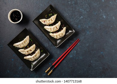 Original Japanese dumplings Gyoza with chicken and vegetables. Top view. Flat lay. Dark blue backgrund.
