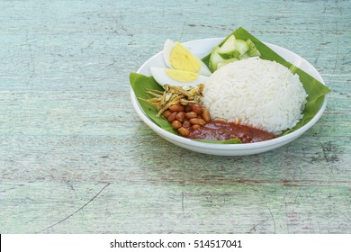 Original Nasik Lemak traditional malaysian food on served outdoors, Banana leaf