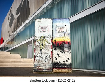"Original piece of Berlin Wall in Weimar in East Germany / The german Text on it says: ""Caution! You are NOW leaving West Berlin"""