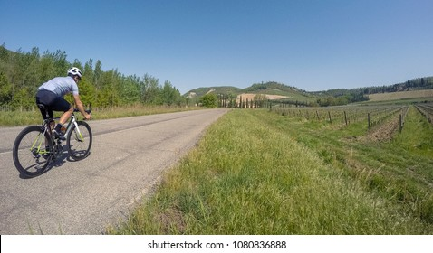 Original point of view of cyclist on road bike. Cycling in summer season on tipical Italy scenary