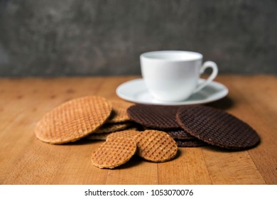 original stroopwafels Dutch tradition dessert serve with hot coffee on wood table. famous dessert of Holland made from dough and syrup inside