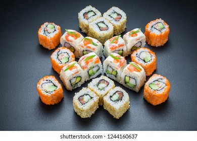 Original sushi roll set with salmon and crab meat served on a dark background