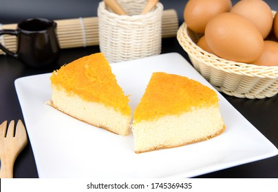 "The original Thai cake is made from egg yolks, sweet coconut milk and brown sugar called ""Foi Thong Cake"" which are cut in 2 pieces and placed on a plate."