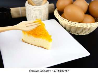 "The original Thai cake is made from egg yolks, sweet coconut milk and brown sugar called ""Foi Thong Cake"", placed on a plate."