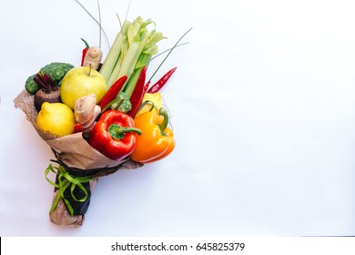The original unusual edible bouquet of vegetables and fruits on white with copy space