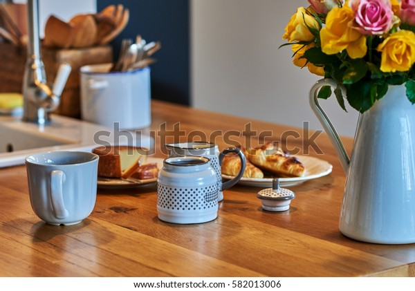 Original vintage kitchen with porcelain tea set on the table.