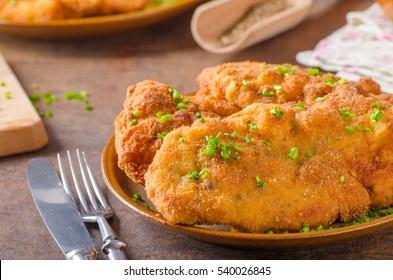 Original Weiner schnitzel with potatoes and herbs