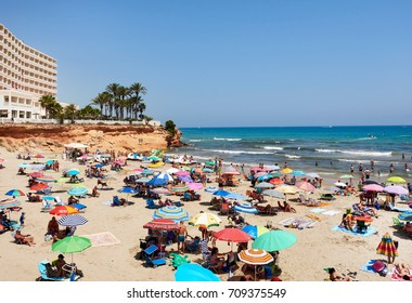 Orihuela, Spain - August 17, 2017: People enjoying the summer on the beach of La Zenia, Orihuela coast. Costa Blanca. Spain